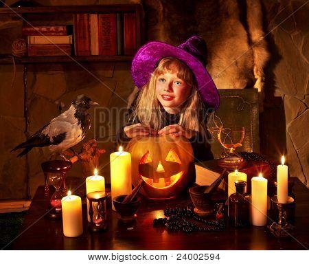 Witch  with pumpkin lantern. Halloween.