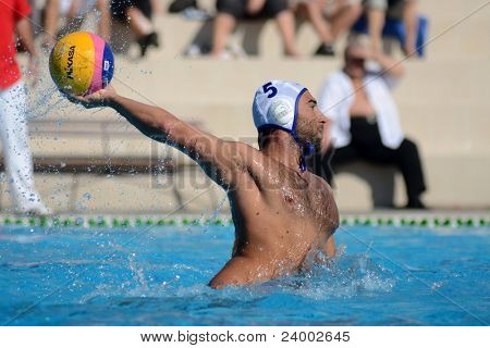 KAPOSVAR, HUNGARY - OCTOBER 1: Verac Blaz in action at a Hungarian national championship water-polo game between Kaposvar (white) and Honved (green) on October 1, 2011 in Kaposvar, Hungary