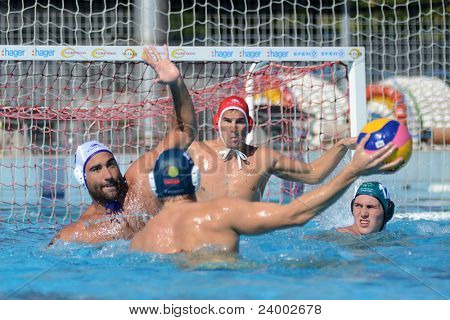 KAPOSVAR, HUNGARY - OCTOBER 1: Verac Blaz (in white) in action at a Hungarian national championship water-polo game between Kaposvar (white) and Honved (green) on October 1, 2011 in Kaposvar, Hungary