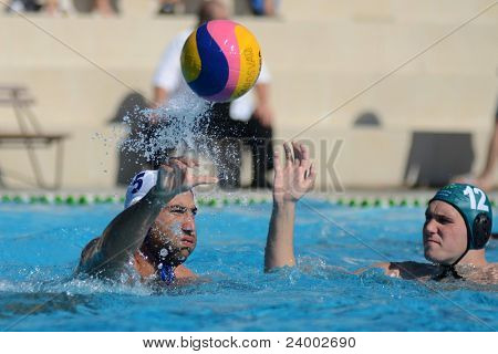 KAPOSVAR, HUNGARY - OCTOBER 1: Verac Blaz (white 5) in action at a Hungarian national championship water-polo game between Kaposvar (white) and Honved (green) on October 1, 2011 in Kaposvar, Hungary
