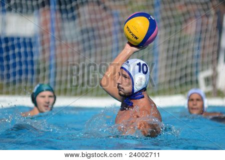 KAPOSVAR, HUNGARY - OCTOBER 1: Zoltan Balogh (w 10) in action at a Hungarian national championship water-polo game between Kaposvar (white) and Honved (green) on October 1, 2011 in Kaposvar, Hungary