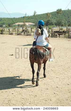 Back Of Woman Riding Horse