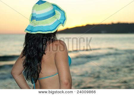Back Of Woman Watching Sea Water