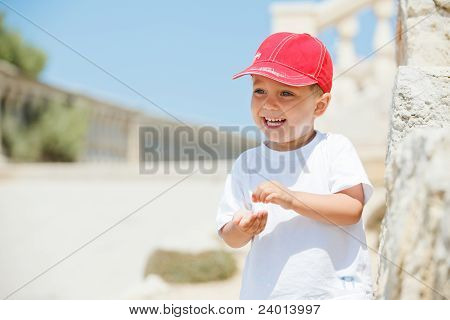 Portrait of cute boy in a red cap