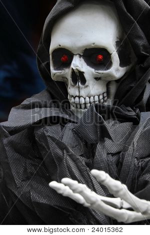 Grim reaper, scary halloween skeleton.