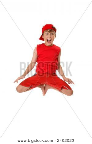 Excited Boy Jumping Off The Ground.