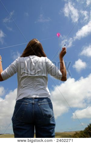 Woman Flying A Kite.
