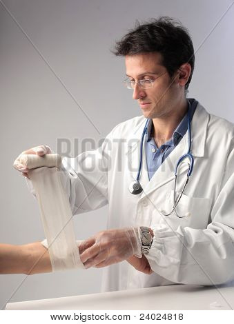Doctor medicating a man's arm