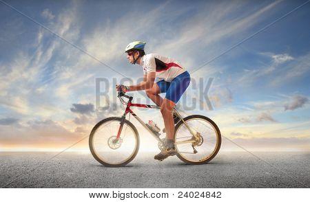 Cyclist riding a mountain bike ona street