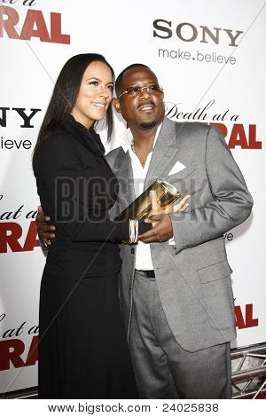 LOS ANGELES - APR 12: Martin Lawrence and guest at the World Premiere of 'Death At A Funeral' held at the Arclight Theater in Los Angeles, California on April 12, 2010