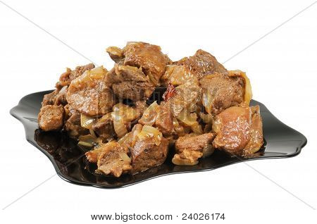 Stew with onions on a plate.