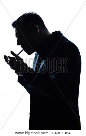 one caucasian man portrait smoking lighting cigarette silhouette in studio isolated white background