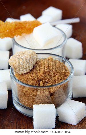 Several types of sugar - refined sugar, brown sugar and granulated sugar