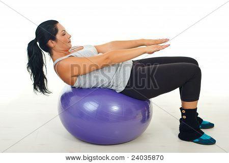 Woman Doing Exercise On Pilates Ball