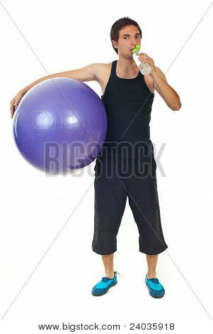 Fitness Man Holding Ball And Drink Water