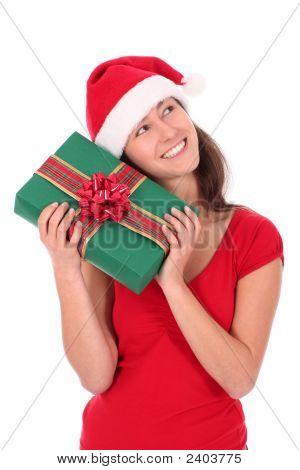 Woman In Santa Hat Holding Gift Box
