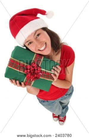 Woman In Santa Hat Holding Gift Box