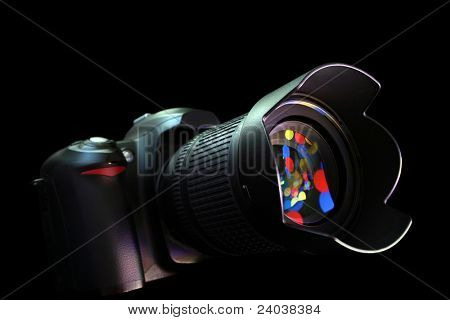 digital photo camera on black background