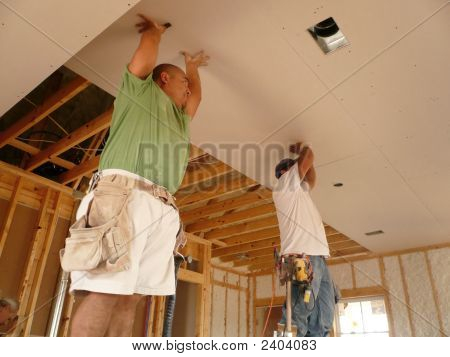 Sheetrockers Holding Up The Ceiling Sheetrock