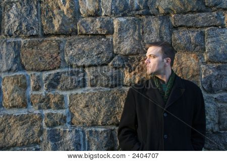Man Leans Against Wall