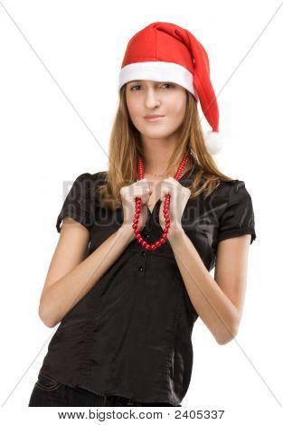 Menina bonita no tampão vermelho Santas