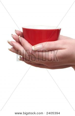 Red Cup In Female Hands On A White Background