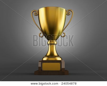 Gold trophy cup on a grey background