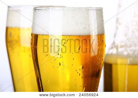 Two glasses and Bottle of fresh light beer