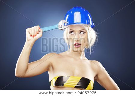 Beautiful Girl With Construction Helmet And Adjustable Wrench.