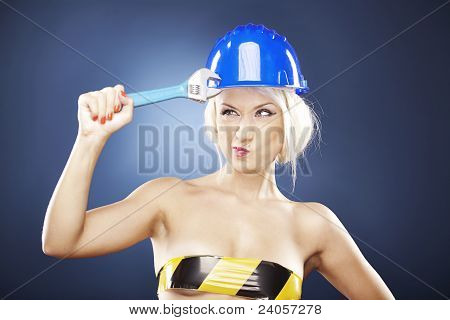 Beautiful Blonde Model With Adjustable Wrench.
