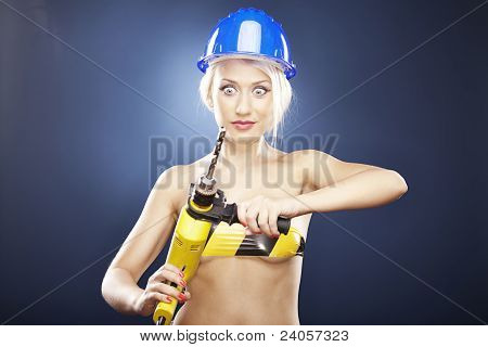 Surprised Girl With Power Drill And Helmet