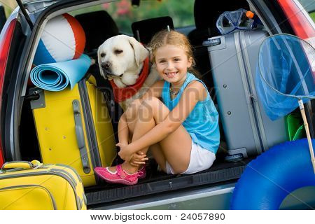 Travel, tourism - Girl with dog ready for the travel for summer vacation