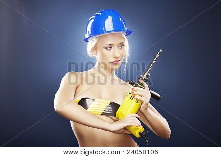 Beautiful Blonde Model With Power Drill And Helmet