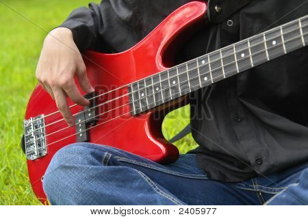 Man Playing The Bass Guitar