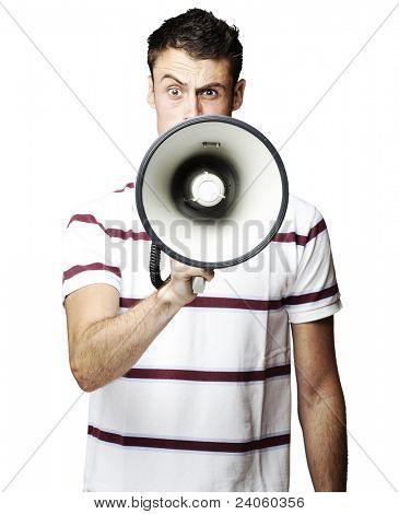 portrait of young man shouting using megaphone over white background