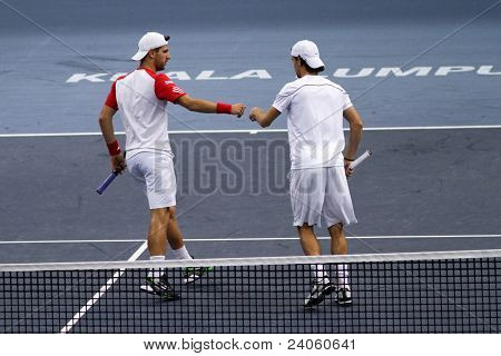 BUKIT JALIL - OCT 01: Philipp Petzschner acknowledges Jurgen Melzer (red) in this Malaysian Open semi-final doubles game vs Cermak/Polasek on October 01, 2011 in Putra Stadium, Bukit Jalil, Malaysia.