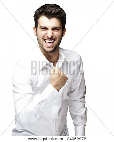 portrait of young man winner gesture against a white background