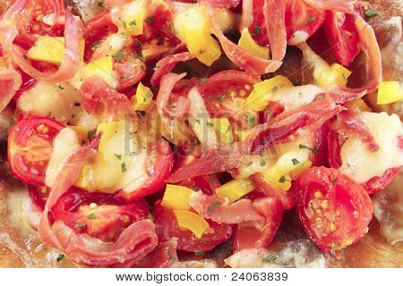 close-up of a pizza topping with vegetables  ham