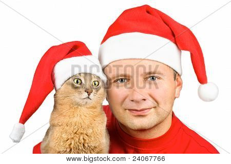 Young Smiling Man And Cat In Santa's Hat, Isolated