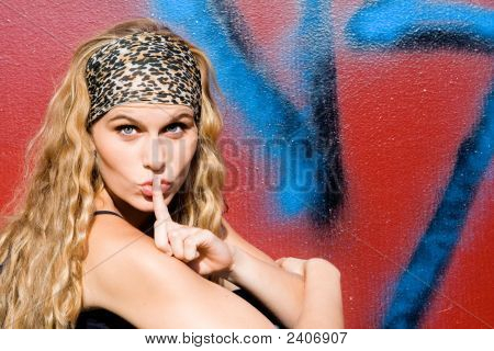 Trendy Young Woman With Finger To Lips
