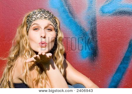 Beautiful Woman Blowing Kiss