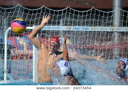 KAPOSVAR, HUNGARY - OCTOBER 1: Peter Nagy (in red) in action at a Hungarian national championship water-polo game Kaposvar (white) vs. Honved (green) on October 1, 2011 in Kaposvar, Hungary