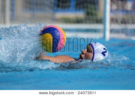 KAPOSVAR, HUNGARY - OCTOBER 1: Robert Maar (white 2) in action at a Hungarian national championship water-polo game Kaposvar (white) vs. Honved (green) on October 1, 2011 in Kaposvar, Hungary