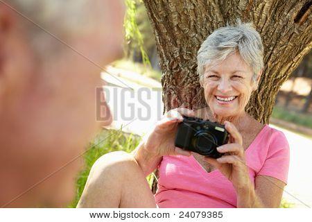 Senior woman with camera