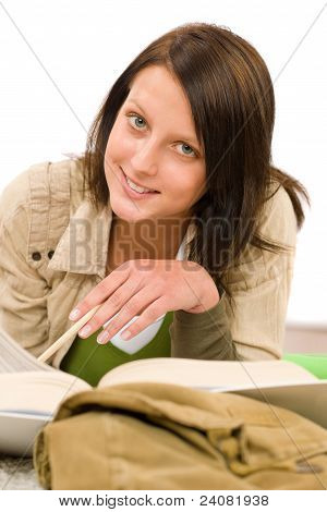 Student Female Teenager Write Homework With Book