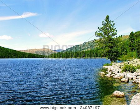 view of the lake with beaches and mountain views