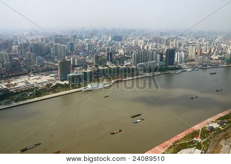 Boat on Huangpu River with building