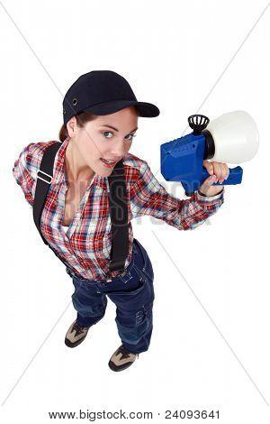 sexy craftswoman holding a sprayer