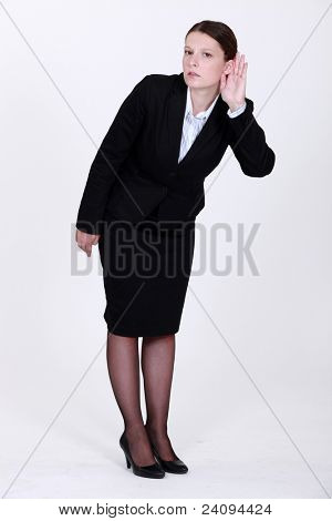 Businesswoman straining her ear