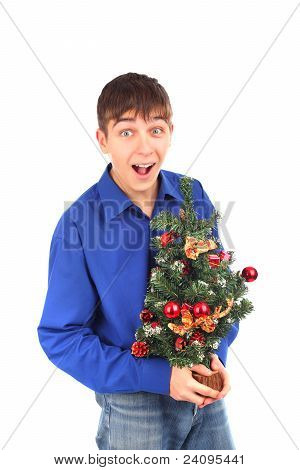 Teenager With Christmas Tree
